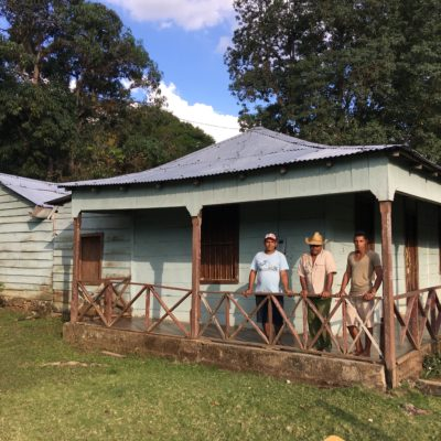 Juan, his son Miguel, and grandson Miguel at Lucas's historical house, now a museum.  While living in this house, Juan watched as Che Guevara test-fired his Molotov cocktail from the left side of this yard.  Fidel Castro slept in the bedroom at the far right.